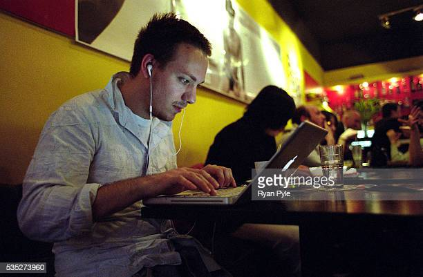 A man surfs the internet and listens to music at the trendy Boona Cafe Shanghai is China's largest and most dynamic city It's modern and ever...