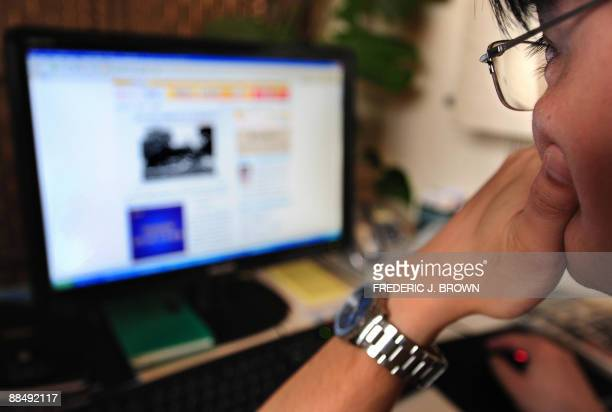 A man surfs the internet in Beijing on June 15 2009 The designers of controversial Internet filtering software that China has ordered shipped with...