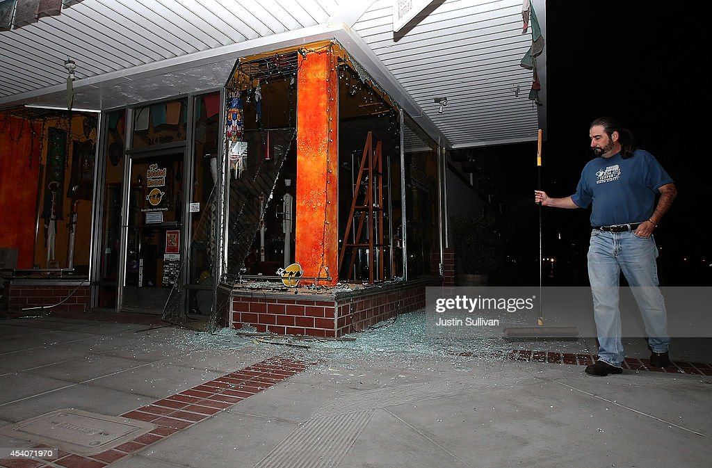 A man surveys a destroyed building following a reported 6.0 earthquake on August 24, 2014 in Napa, California. A 6.0 earthquake rocked the San Francisco Bay Area shortly after 3am on Sunday morning.