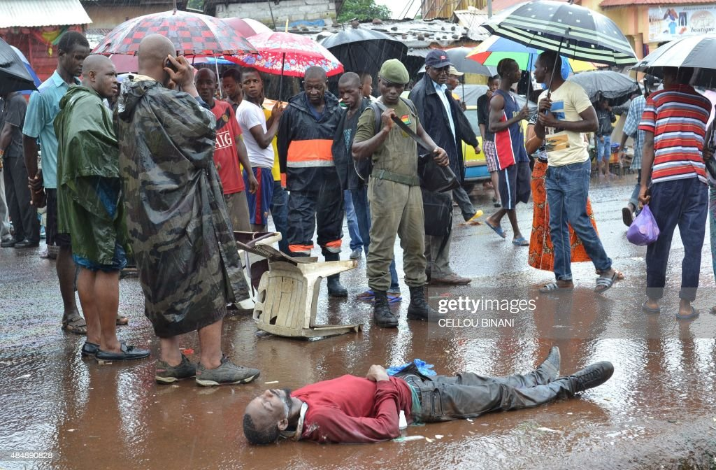 A man suspected of being infected with ebola lies dead in the street in Conakry on August 21 2015 AFP PHOTO / CELLOU BINANI