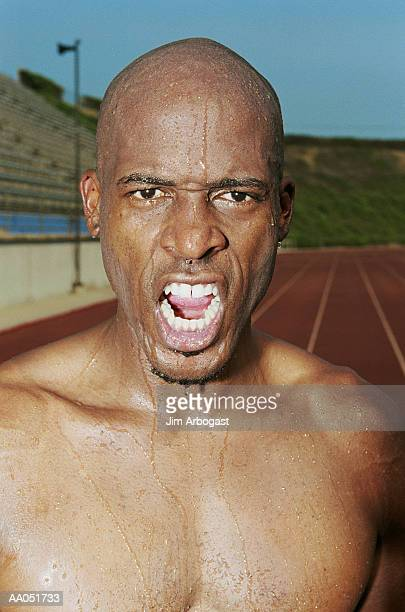 Man sweating after running race, close-up