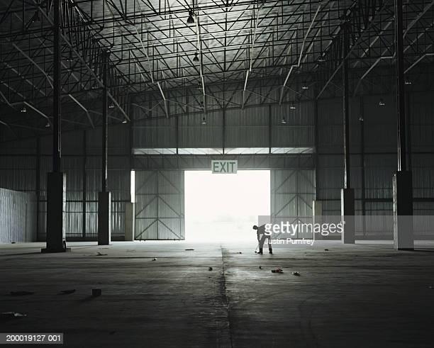 Man sweeping warehouse
