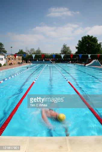 Man swimming in Hampton Lido, London, UK