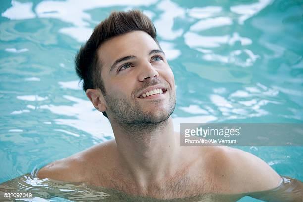 Man swimming in pool, portrait