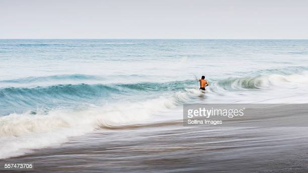 Man swimming in waves