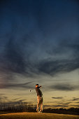 Man swinging at golf course
