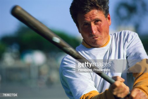 Men very man swinging bat Ives