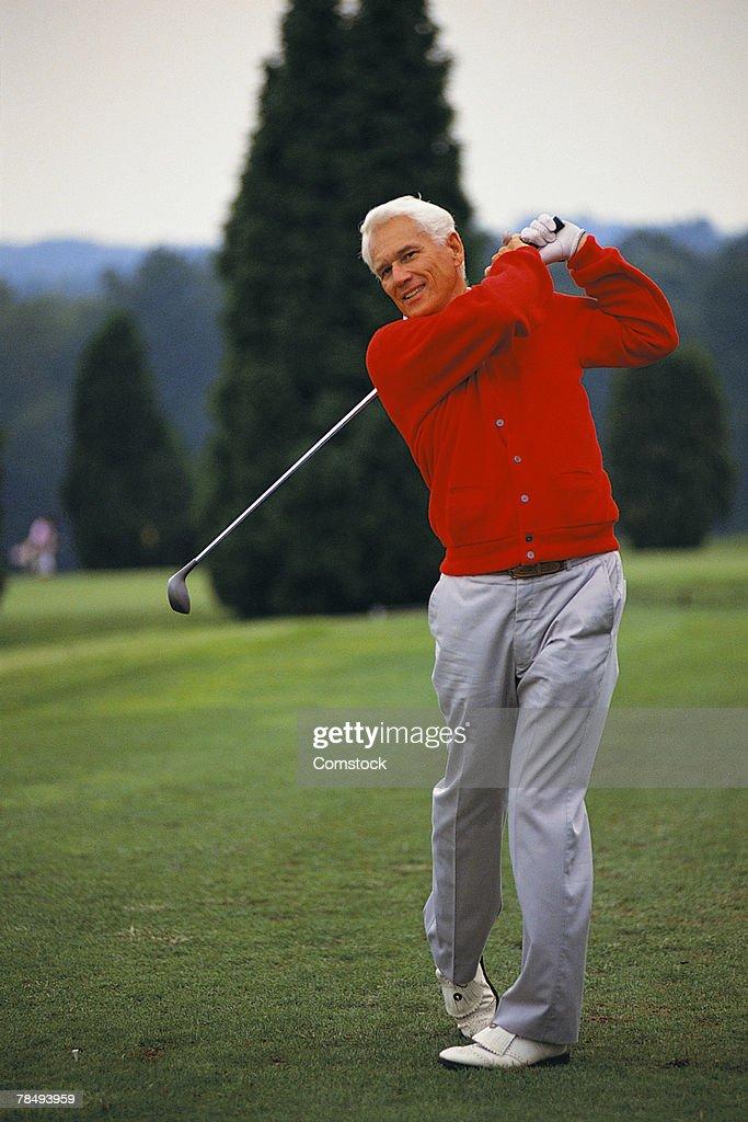 Swinging the golf