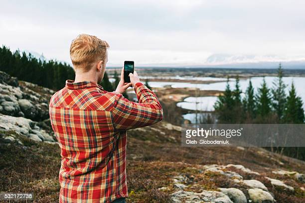 Man take photo on smartphone