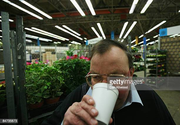 A man takes a break beside his stall in New Covent Garden Flower Market on February 11 2009 in London England New Covent Garden Flower Market is...