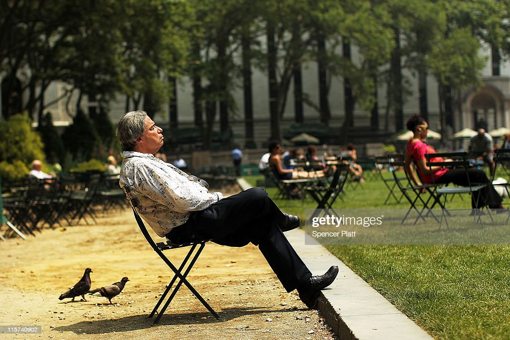 A man takes a break in Bryant Park during a heat wave on June 9, 2011 in New York City. With the high today in Central Park expected to reach 99 degrees, a 78-year-old record is set to be broken. Some schools have been let out early due to the heat and Manhattan has opened cooling stations throughout the city. Temperatures are expected to drop into the mid-70s by tomorrow.