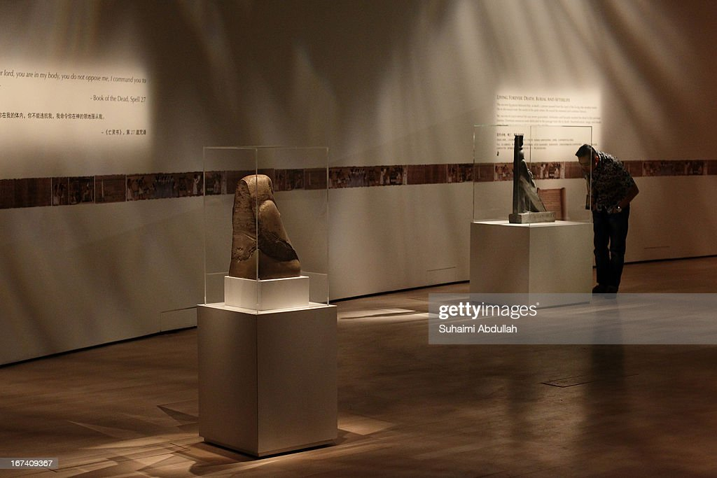 A man takes a closer look at the exhibit during a media preview of the Mummy: Secrets of the Tomb exhibition at ArtScience Museum on April 25, 2013 in Singapore. The exhibition includes more than 100 artifacts and six mummies from the heralded ancient Egyptian collection of the British Museum. Among the mummies displayed is the Egyptian temple priest, Nesperennub who lived 3,000 years ago. The exhibition will run from April 27 till November 4, 2013.
