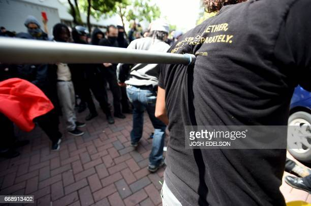 A man takes a hit in the back with a pole as multiple fights break out between Trump supporters and antiTrump protesters in Berkeley California on...