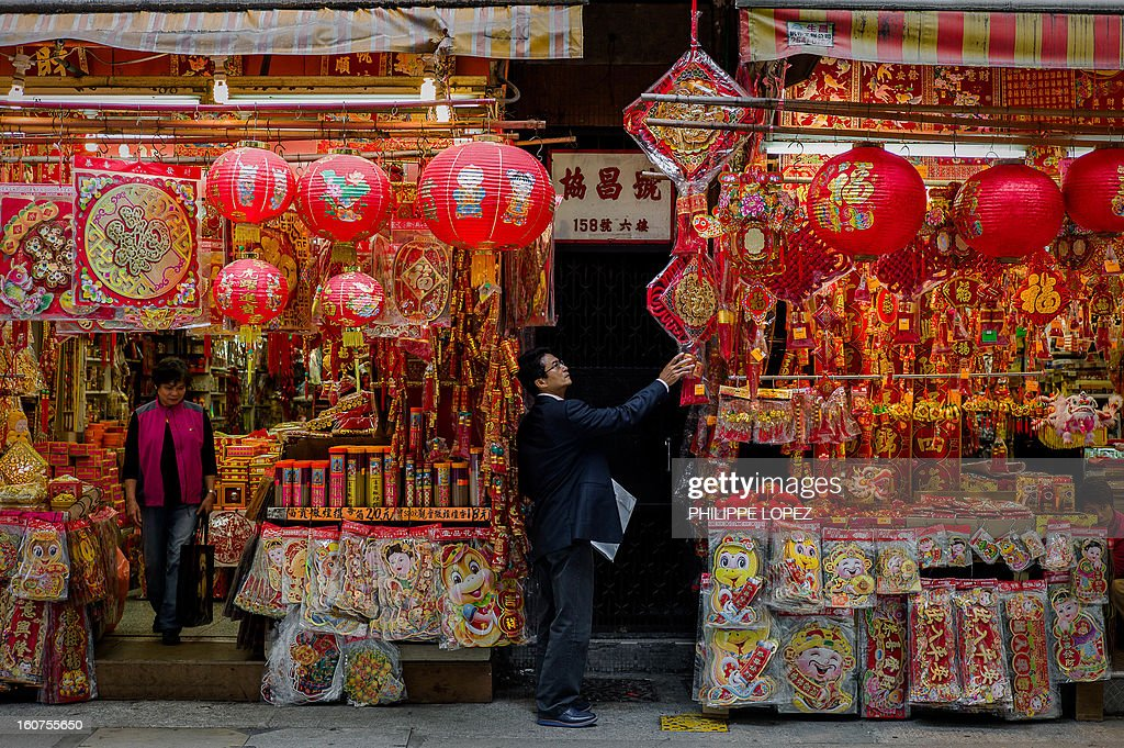 A man takes a look at a display of Chinese New Year decorations in Hong Kong on February 5, 2013. The Chinese New Year festival falls on February 10, 2013. AFP PHOTO / Philippe Lopez