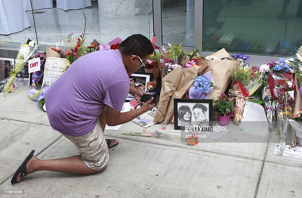 A man takes a photo at a memorial to deceased actor Cory Monteith outside the Fairmont Pacific Rim Hotel on July 16, 2013 in Vancouver, British Columbia, Canada. The B.C. Coroners Service released results of Monteith's autopsy today and found the 31-year-old's cause of death was a mixed drug toxicity involving heroin and alcohol.