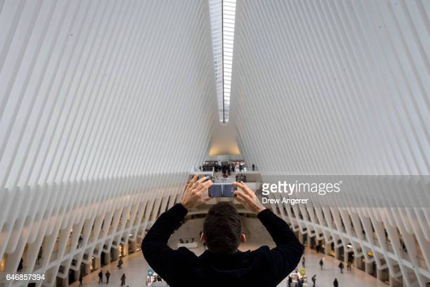 A man takes a photo inside the Oculus at the World Trade Center Transportation Hub March 1 2017 in New York City NYC Company the city's tourism...
