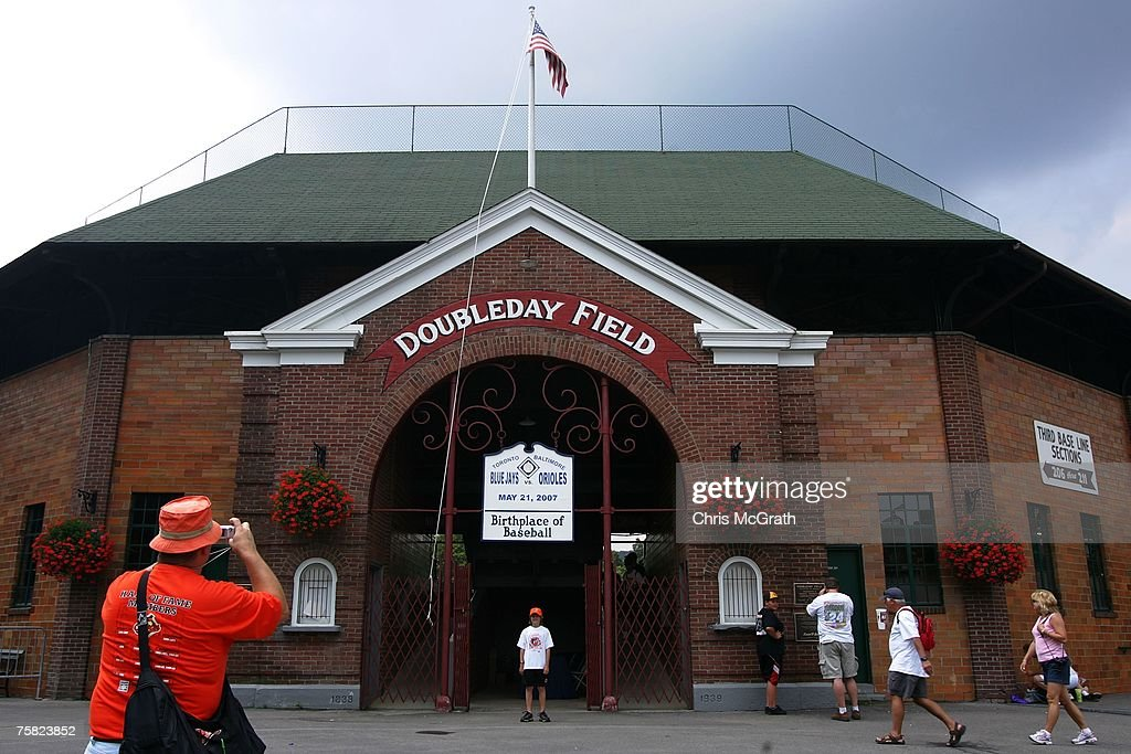 A man takes a photo outside Doubleday Field on July 27 2007 in Cooperstown New York Thousands of baseball fans have arrived in Cooperstown for this...