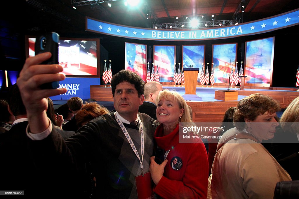 A man takes a photo with a smartphone in front of the stage during Mitt Romney's campaign election night event at the Boston Convention & Exhibition Center on November 6, 2012 in Boston, Massachusetts. Voters went to polls in the heavily contested presidential race between incumbent U.S. President Barack Obama and Republican challenger Mitt Romney.