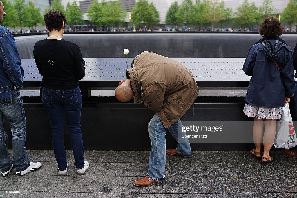 A man takes a picture at the South reflecting pool at the Ground Zero memorial site after authorities opened the plaza to the public free of charge on May 16, 2014 in New York City. Prior to today, visitors had to wait in line to enter a barricaded area which includes the newly dedicated National September 11 Memorial Museum. Together with the museum, Ground Zero has become one of the top tourist attractions in the nation with tens of thousands of visitors expected yearly.