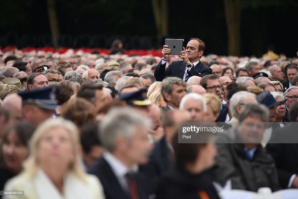A man takes a picture during the Commemoration of the Centenary of the Battle of the Somme at the Commonwealth War Graves Commission Thiepval Memorial on July 1, 2016 in Thiepval, France. The event is part of the Commemoration of the Centenary of the Battle of the Somme at the Commonwealth War Graves Commission Thiepval Memorial in Thiepval, France, where 70,000 British and Commonwealth soldiers with no known grave are commemorated.