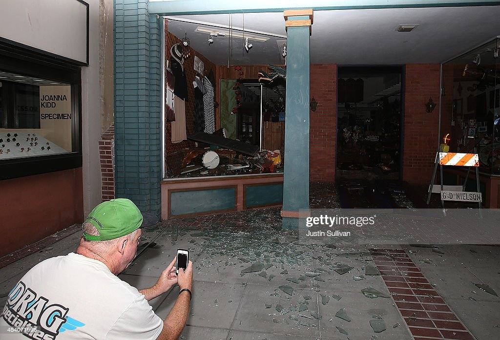 A man takes a picture of a destroyed building following a reported 6.0 earthquake on August 24, 2014 in Napa, California. A 6.0 earthquake rocked the San Francisco Bay Area shortly after 3am on Sunday morning.