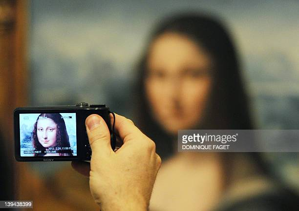 A man takes a picture of an authenticated contemporary copy of Leonardo da Vinci's Mona Lisa presented at the Prado Museum in Madrid on February 21...