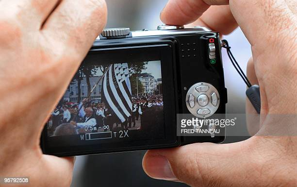 A man takes a picture on August 2 2009 in Lorient western France during the celtics nations Great Parade of the 'festival interceltique de Lorient'...