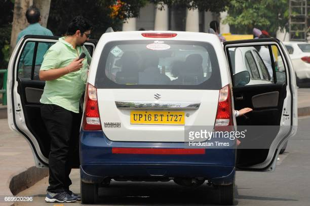 A man takes a private cab as Ola and Uber drivers went for a oneday strike for the second time this year on April 18 2017 in New Delhi India The...