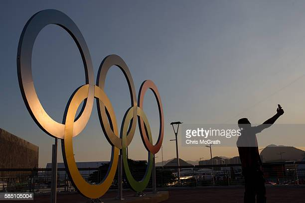 A man takes a selfie in front of the Olympic rings in Olympic Park ahead of the Rio 2016 Olympic Games on August 1 2016 in Rio de Janeiro Brazil The...