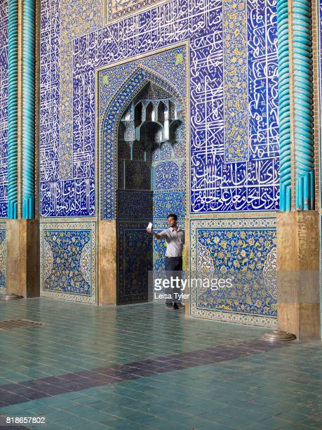 A man takes a selfie inside Lotfollah Mosque the first mosque to be built on Esfahan's iconic Naqshe Jahan Square Iran Shah Abbas built it as a...