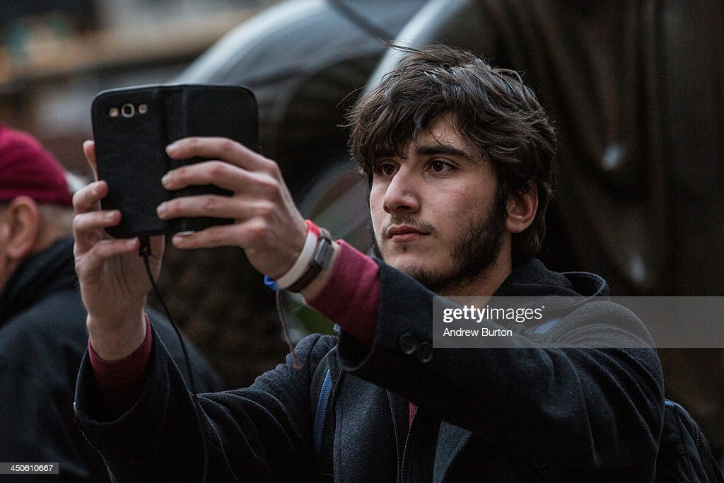 A man takes a 'selfie' outside Rockefeller Center on November 19, 2013 in New York City. Oxford Dictionary named 'Selfie' the new word of the year. The word is defined as 'a photograph that one has taken of oneself, typically with a smartphone or webcam and uploaded to a social media website.' The terms 'binge-watch' and 'twerk' were shortlisted.