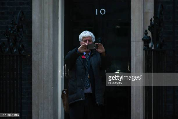 A man takes a 'selfie' outside the iconic Number 10 of Downing Street London on November 8 2017