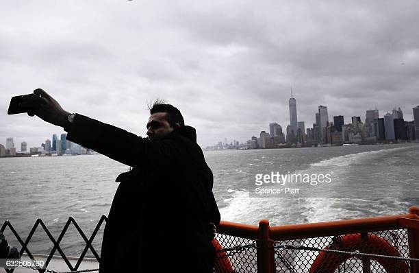 A man takes a selfie picture as Manhattan prepares for a nor'easter storm on January 23 2017 in New York City The storm is expected to bring at least...