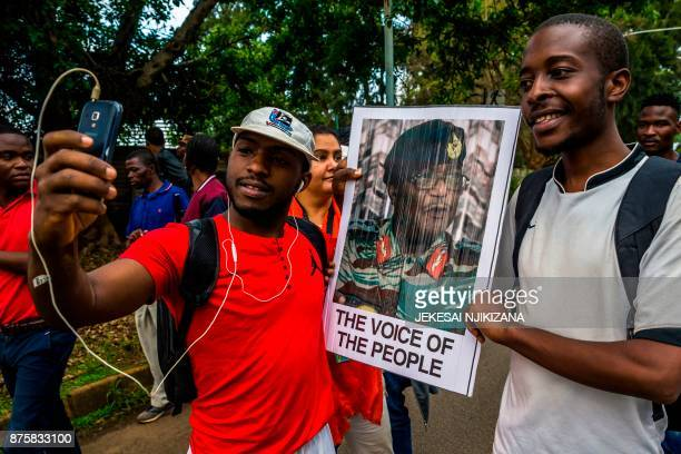 A man takes a selfie picture with the portrait of Zimbabwean Defence Force chief Constantino Chiwenga as people demonstrate to demand the resignation...