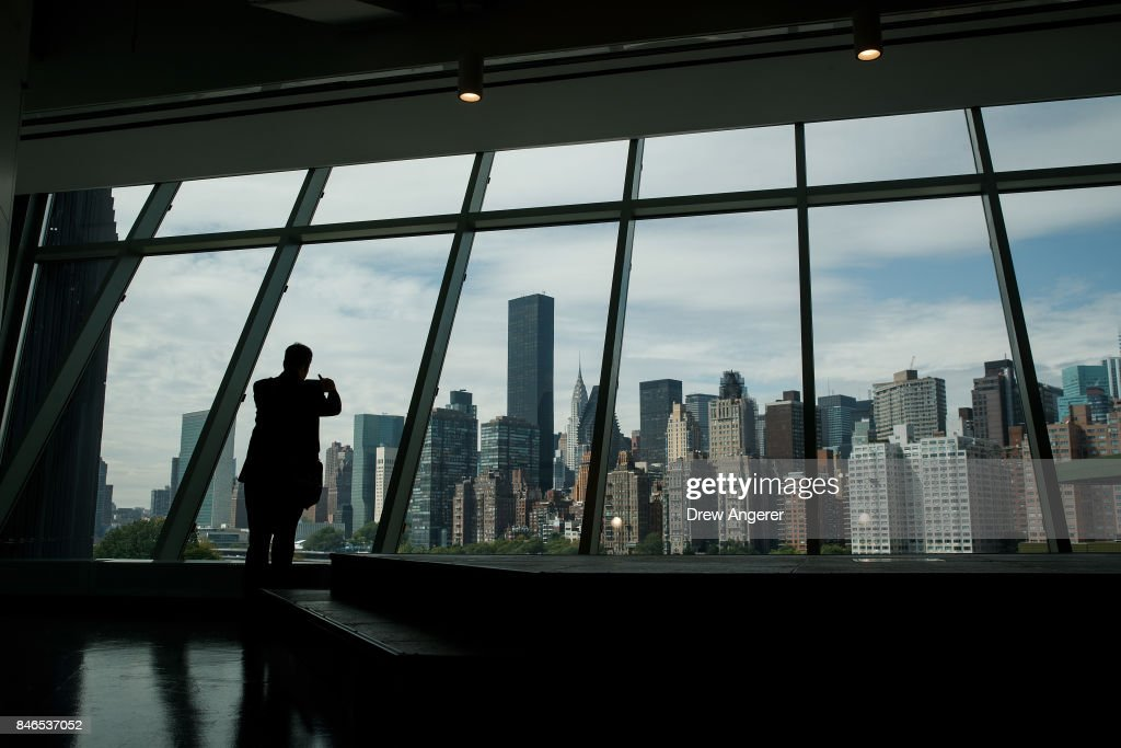 A man takes in the view of the New York City skyline from the 'The Bridge' building on the new campus of Cornell Tech on Roosevelt Island, September 13, 2017 in New York City. Seven years ago, former New York City Mayor Michael Bloomberg created a competition that invited top universities to open an applied-science campus in New York City. Cornell Tech, an engineering and science campus of Cornell University, officially opened its doors on Wednesday.