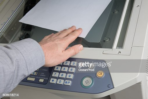 Man takes out  documents from printer or photocopier : Stock Photo