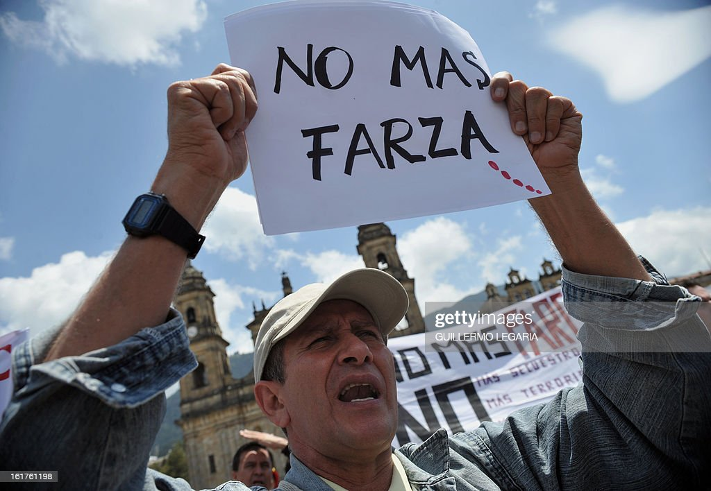 A man takes part in a protest against the Revolutionary Armed Forces of Colombia (FARC) guerrillas and to ask for the release of hostages on February 15, 2013 in Bogota, Colombia. The protest aims to reject the latest terrorist attacks and abductions of civil and military people while the guerrillas hold peace negotiations with the government in Havana, Cuba. AFP PHOTO/Guillermo LEGARIA