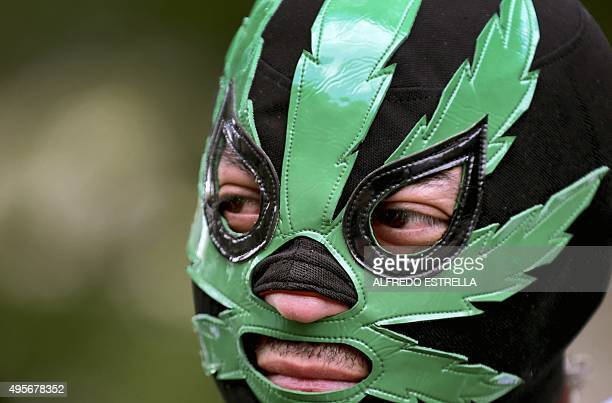 A man takes part in a rally supporting the legalization of marijuana in front of the Supreme Court of Justice in Mexico City on November 4 2015...