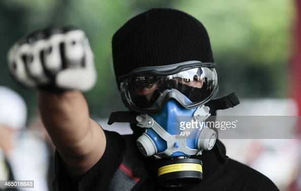 A man takes part in the 'Nao Vai Ter Copa' protest along Avenue Paulista in Sao Paulo Brazil on January 25 2014 Brazil was bracing Saturday for a...