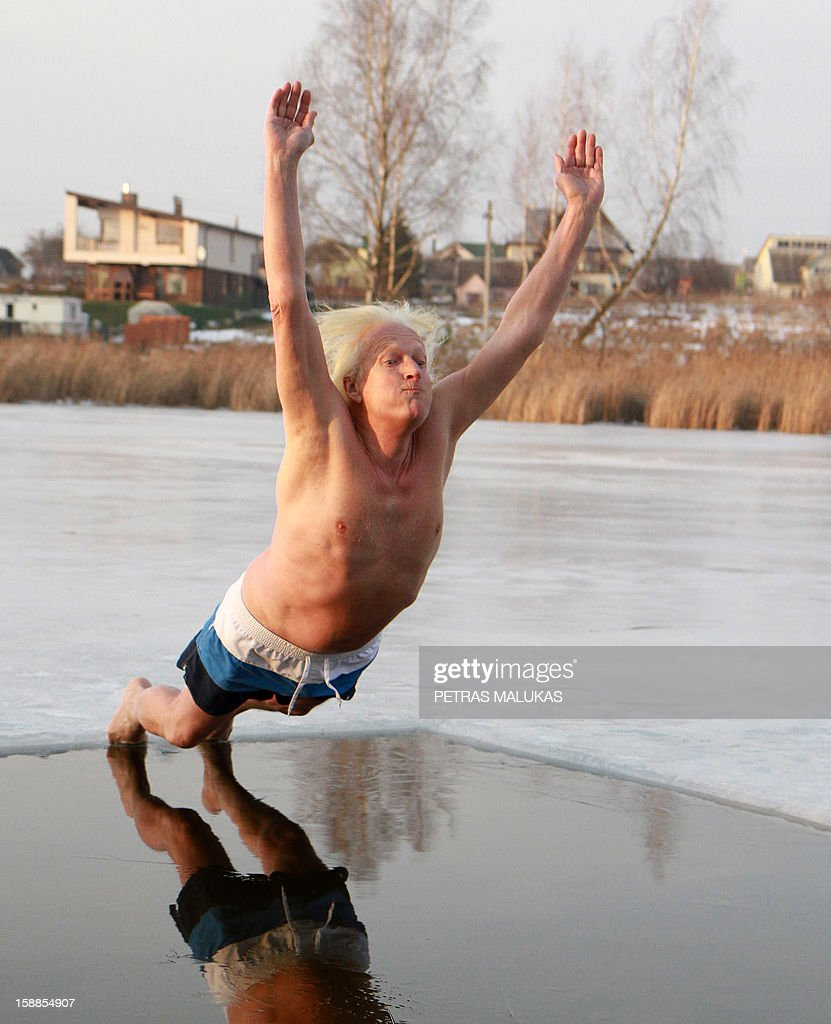 A man takes part in the traditional New Year's swimming at the Geluzis Lake, on January 1, 2013 in Vilnius, Lithuania.