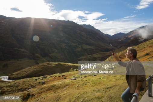 Man takes picture by roadside, near Furka Pass : ストックフォト