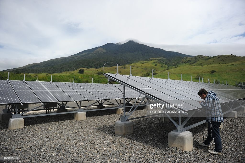 A man takes pictures at the Miravalles Solar Power Plant in Miravalles, 220 km north of San Jose, on November 22, 2012. Costa Rica inaugurated the largest plant of electricity from solar energy in Central America, which may generate 1.2 gigawats a year and was built with funds from the Japanese government. AFP PHOTO/Rodrigo ARANGUA