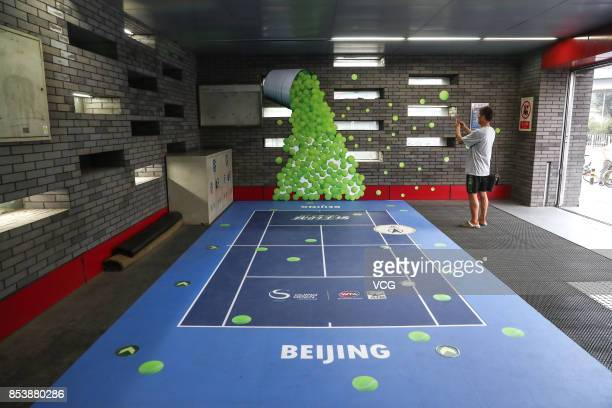 A man takes pictures in the Lincuiqiao Station which has been decorated for the upcoming China Open on the Beijing Subway Line 8 on September 25 2017...