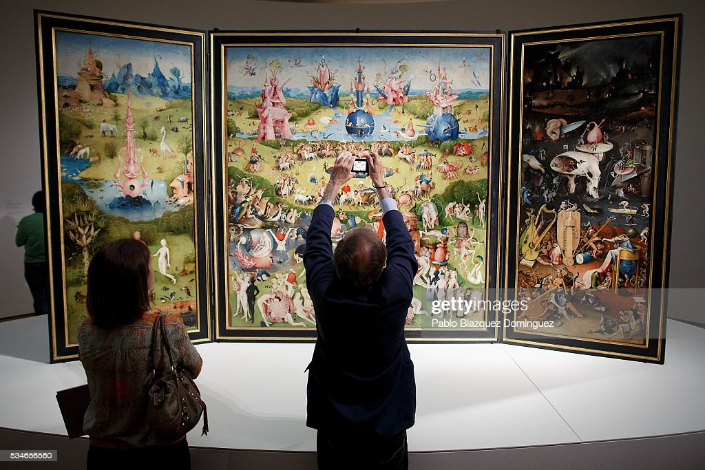 A man takes pictures of 'The garden of earthly delights triptych' from Dutch painter Hieronymus Bosch during a press preview at El Prado Museum on May 27, 2016 in Madrid, Spain. The Prado Museum holds the 'El Bosco' (Hieronymus Bosch) painter major exhibition to celebrate the fifth century anniversary of the Dutch artist's death (ca. 1450-1516) featuring sixty five works from various Spanish and global museums.