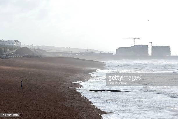 A man takes pictures of the waves on Brighton Beach on March 28 2016 in Brighton England Yesterday the Met Office issued an amber warning for winds...