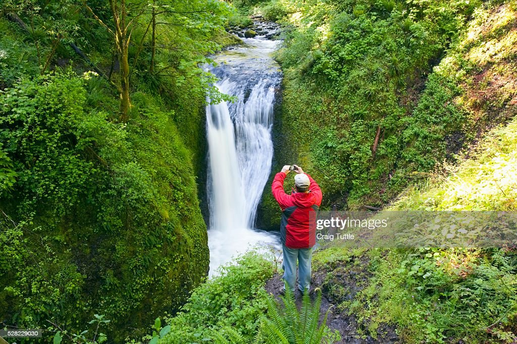 A Man Taking A Picture Of Middle Oneonta Falls In Columbia River Gorge National Scenic Area