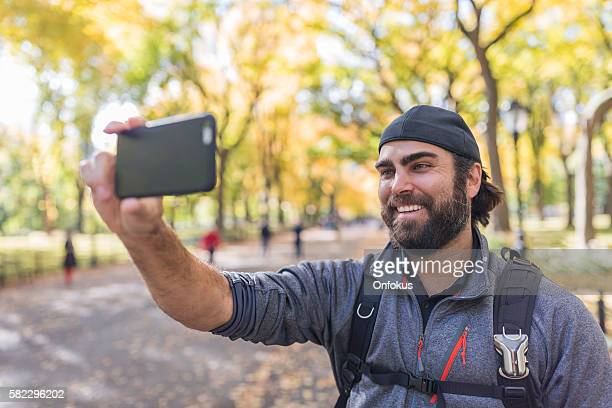 Man Taking a Selfie in Central Park, New York City