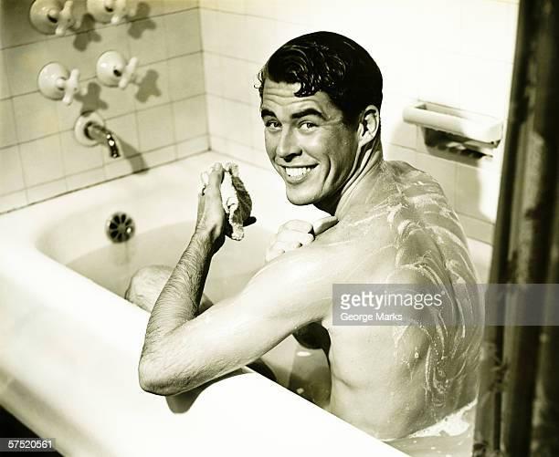 Man taking bath, (B&W)