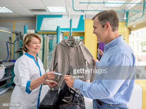 Man Taking Clothes To The Laundry Service Stock Photo | Getty Images