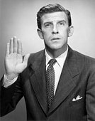 Man taking oath with right hand raised